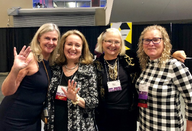 Donna Mertens (2nd from the right) celebrating AEA's thriving status in 2018 with C Deborah Laughton (Guilford Press editor), Tessie Catsambas (AEA President 2019), and Robin Miller (former AJE editor)