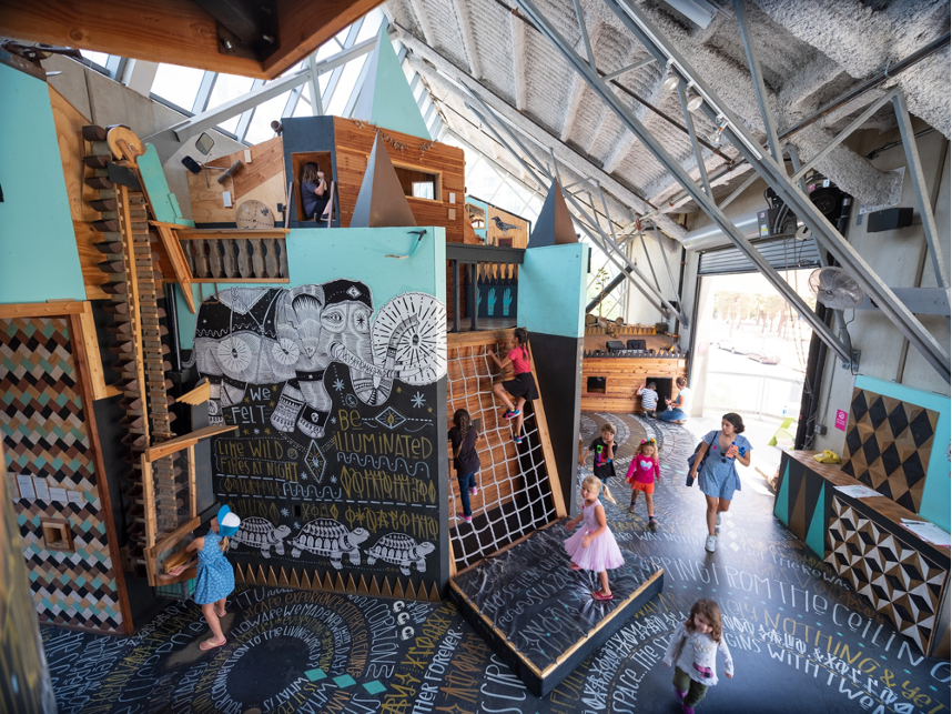 birds-eye view of children climbing and exploring The Wonder Sound exhibition